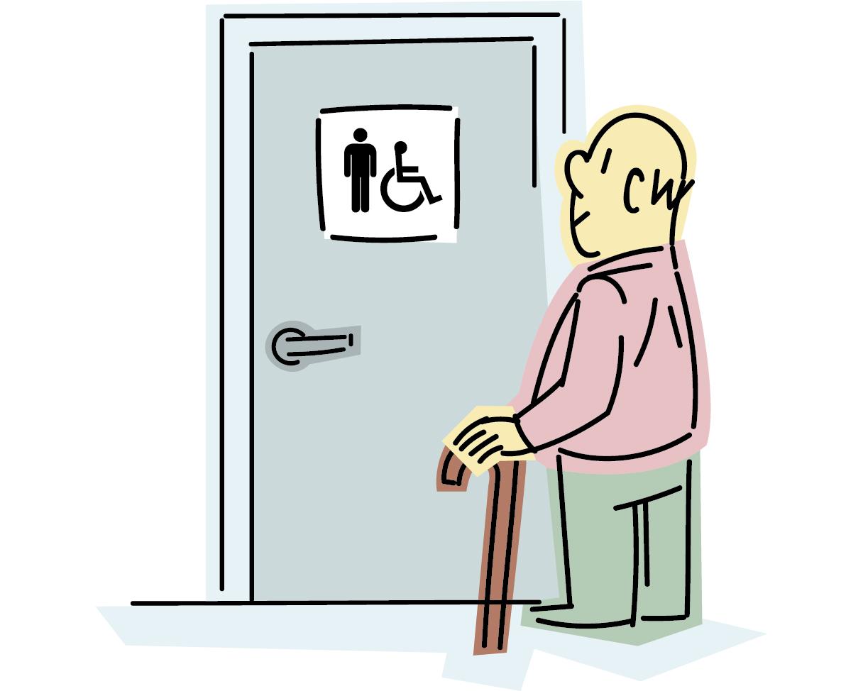 Persona mayor frente a una cabina de aseos señalizada.
